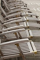 Reclining wooden deckchairs on a cruise ship