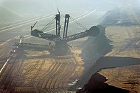 Bucket-wheel excavator in the mist, Tagebau Garzweiler open pit mine, Grevenbroich, North Rhine-Westphalia, Germany, Europe