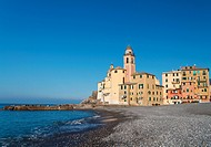 beach and church in Camogli, famous small town in Mediterranean sea, Italy