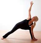 Attractive blonde twenties caucasian woman exercising