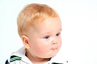 Funny blond baby with blue eyes portrait