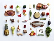 Food Ingredients.A selection of healthy ingredients for cooking against a white table cloth.