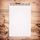 White notebook for painting on wooden background