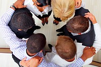 Photo from above of business people showing unity
