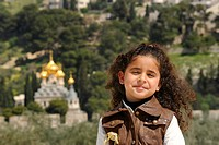 Religious diversity, Israeli_Palestinian girl on the Temple Mount, Russian Orthodox Church of Mary Magdalene on the Mount of Olives at back, Muslim Qu...