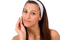 Beauty facial care _ Teenager woman cleaning acne skin with cotton pad on white background