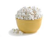 Popcorn on white.popcorn in a bowl on white