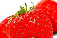 Fresh strawberries closeup isolated on white background