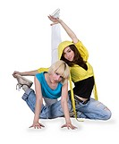 Teenager girls dancing breakdance in action