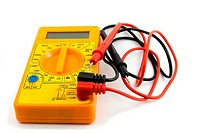 a yellow multimeter with corresponding probes on white background