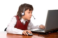 young boy in headset playing with laptop