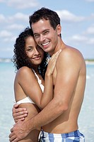 Couple embracing at the beach, portrait