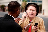 Scared Caucasian businessman with friend on a phone call