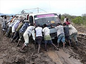 The roads are bad in Ethiopia and all the cars get stuck in the mud
