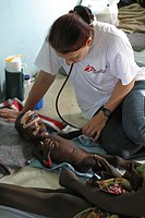MSF doctor examines undernourished child