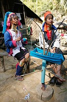 Two women, one old, one young, prepare yarn for weaving Approximately 300 Burmese refugees in Thailand are members of the indigenous group known as th...