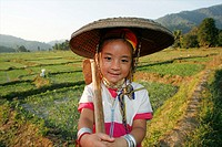 A young Longneck girl in the rice fields Approximately 300 Burmese refugees in Thailand are members of the indigenous group known as the Longnecks The...