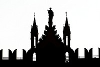 Silhouette of a statue on top of the former Templeton Carpet Factory at Glasgow Green in Scotland UK