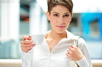 Young businesswoman with a cup of coffee