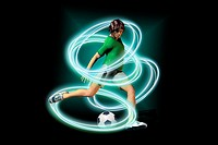 A soccer player amid circles of light and energy