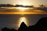 Cabo de Gata-Nijar Natural Park, Almeria Province, Spain  Sunrise through clouds over the sea