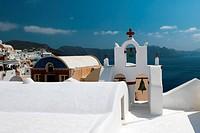 Church on island Santorini with bells