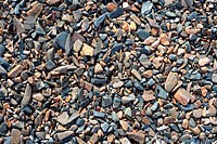 Natural gravel deposit at lake shore. Nature background.