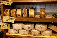 Cheeses in a shop in Pienza, Tuscany Italy