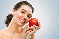 A beautiful girl eating apple