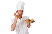 Young attractive nepalese chef male holding a tasty oriental plate. Studio shot. White background.
