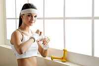 Young woman drinking water after excercise