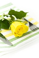Fresh yellow rose, fork and flower. Healthy food concept