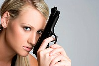 Blond woman holding gun