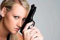Blond woman holding gun