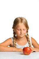 The pretty girl wishes to eat an apple. It is isolated on a white background