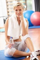 Woman Resting After Exercises In Gym