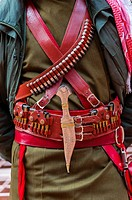 A Bedouin Desert Patrol policeman´s gun belt and dagger at the Treasury monument Al-Khazneh, Petra archaeological site a UNESCO World Heritage site, J...