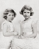 Queen Elizabeth II, right, as a princess circa  1937 and Princess Margaret, left  From The Coronation of their majesties King George VI and Queen Eliz...