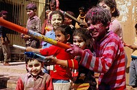 Kids spraying coloured water at the Holi festival, Vrindaban, Uttar Pradesh, India, Asia