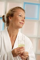 Woman, 40 years, with a glass of water, wellness