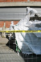 Specialized company in charge of the asbestos removal from an old factory before its demolition.