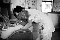 Photo essay in a retirement home at Notre_Dame_de_Gravenchon, France. Alzheimer unit.