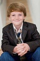 Smiling Caucasian boy in suit