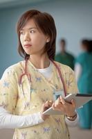 Korean nurse using digital tablet