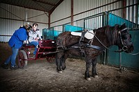 Photo essay at EQUISENS, a therapeutic riding centre in Asniere_les_Dijon France. Hippotherapy session with an autistic man.
