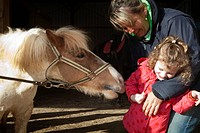 Photo essay at EQUISENS, a therapeutic riding centre in Asniere_les_Dijon France. Hippotherapy session with a child having autistic and behavior disor...