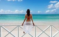 Caribbean  Barbados  Woman on a deserted beach.