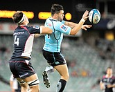 21 04 2012 Sydney, Australia Waratahs winger Adam Ashley_Cooper wins this duel with Rebels Lock Luke Jones during the FxPro Super Rugby game between t...