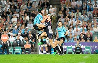 21 04 2012 Sydney, Australia Rebels Centre James O´Connor comes off worst in this duel with Waratahs centre Berrick Barnes during the FxPro Super Rugb...