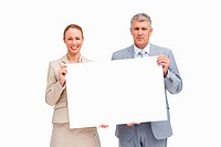 Business people holding a poster against white background